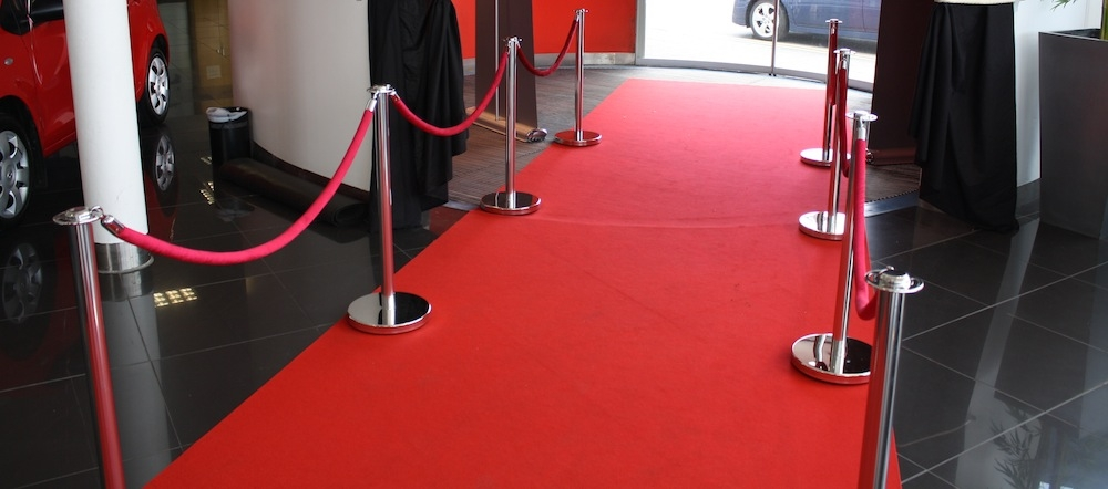 Showroom red carpet vip pole and rope barriers