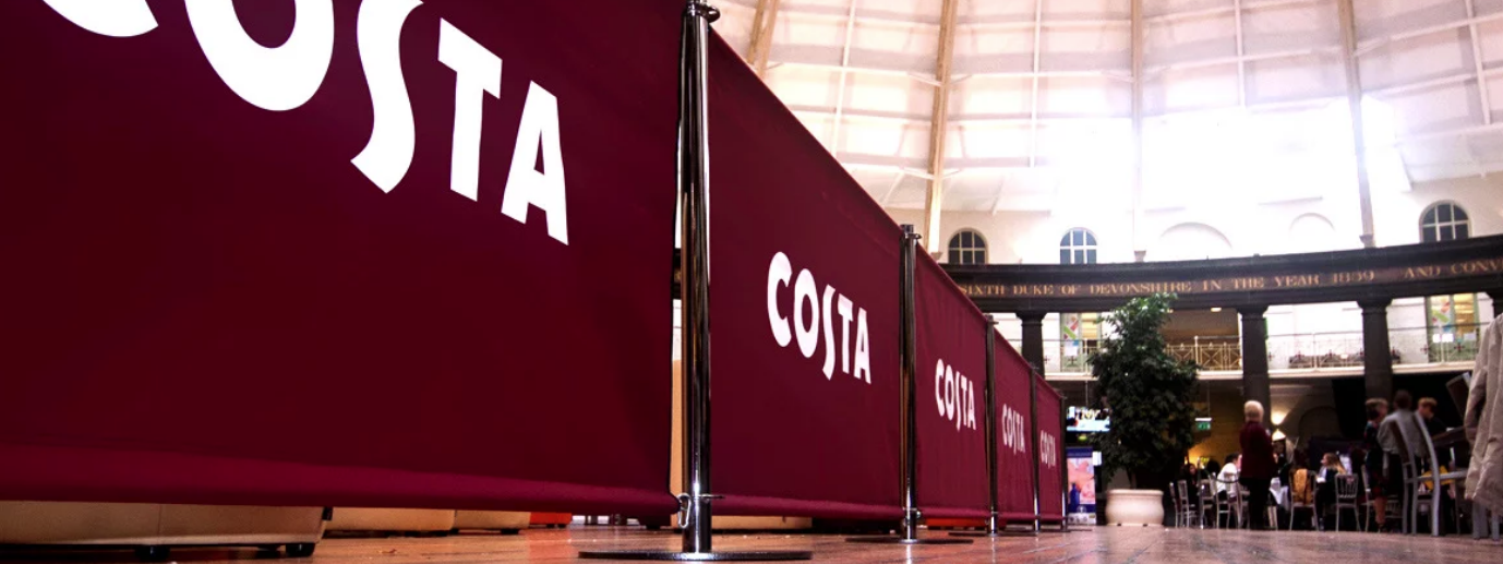 Costa Coffee Cafe Barriers in a long row creating a queue partition