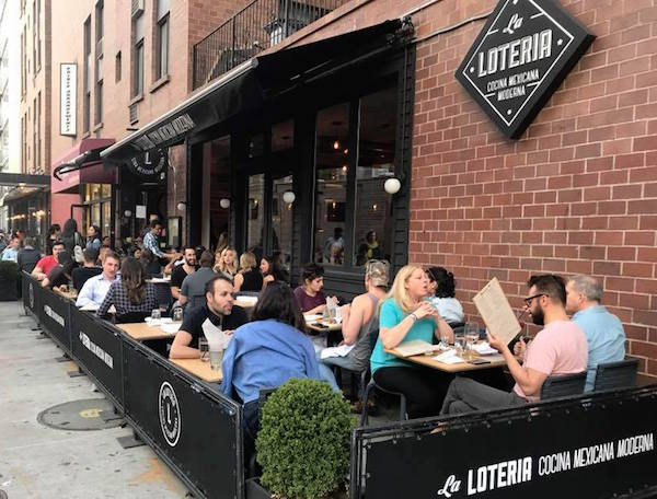 Laloteria Restaurant with outdoor dining and cafe barriers