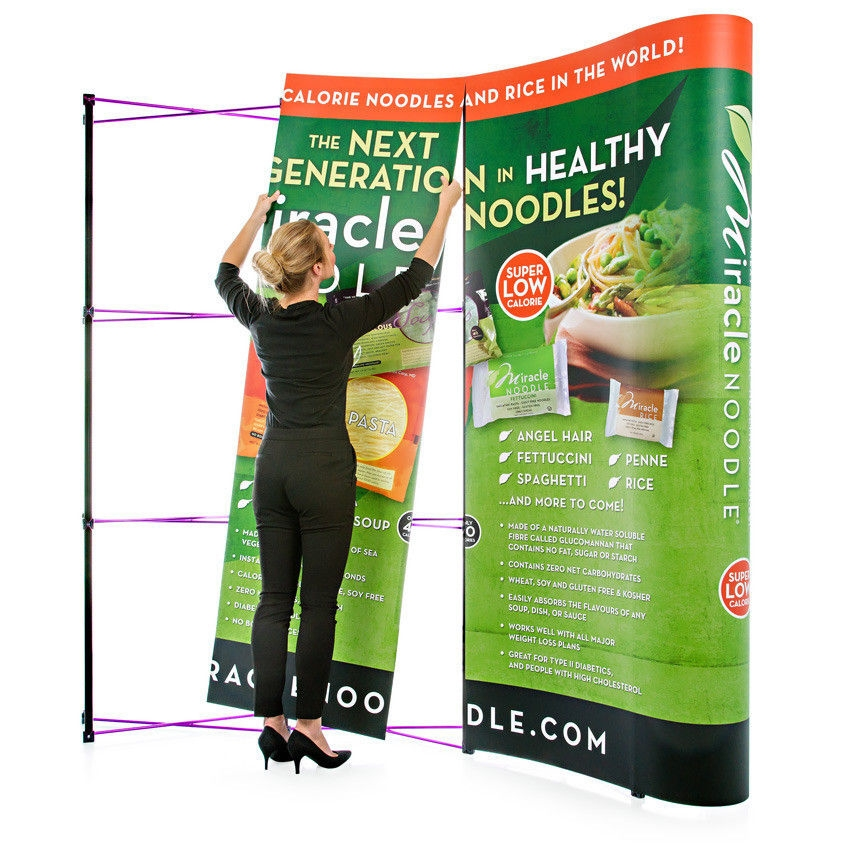 Women Hanging Panel on a Pop-Up Stand Display