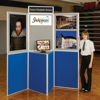 School with pupil showing off work on a panel display board stand