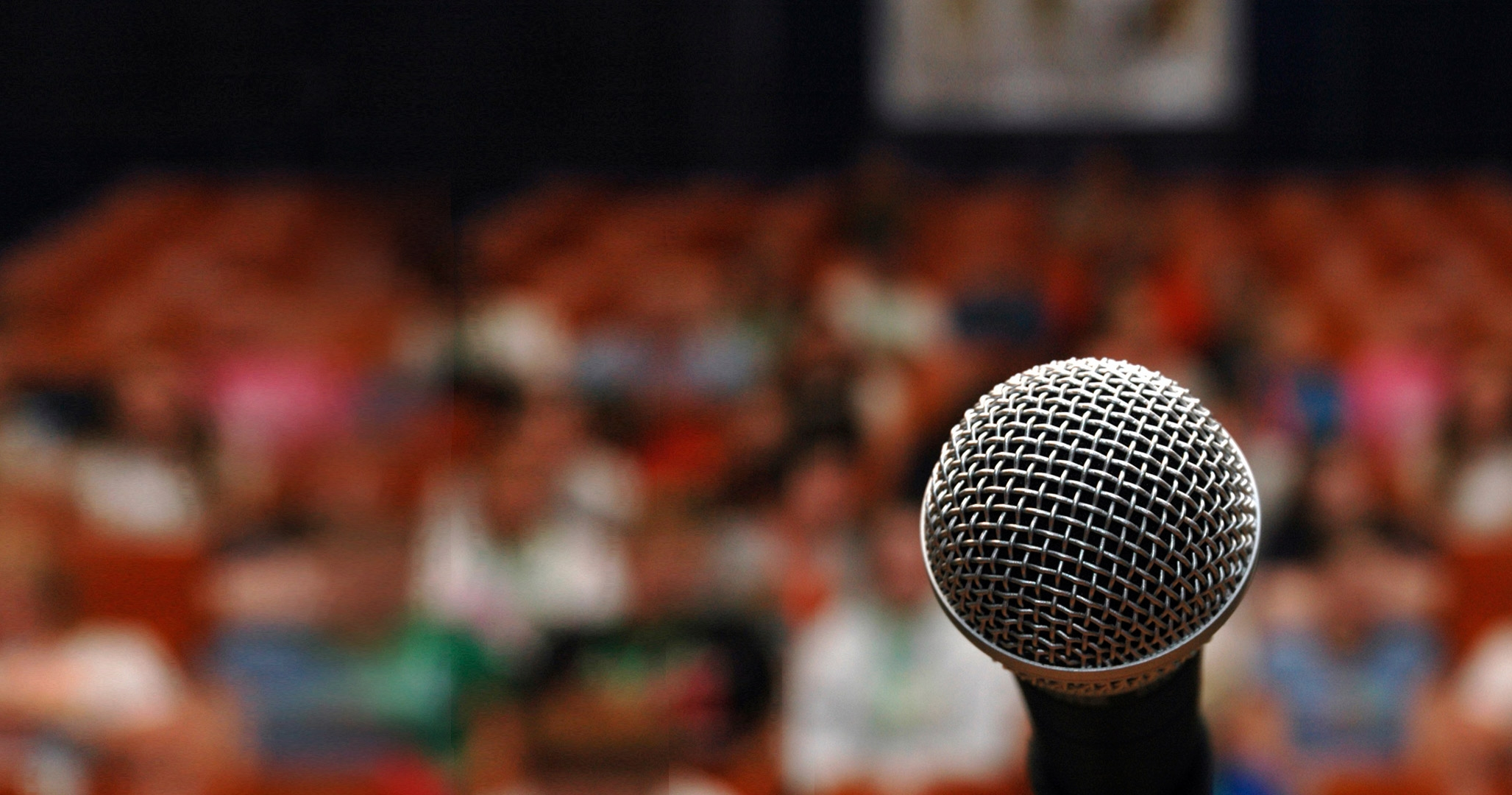 Close up of microphone with crowd