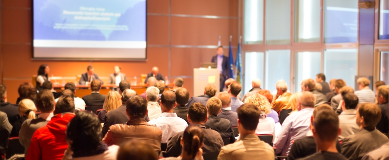 Audience stage conference speaker with lectern