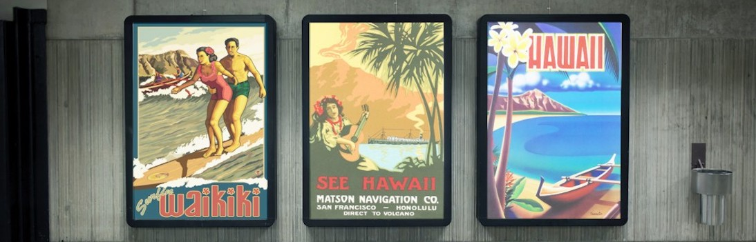3 illuminated light-box poster cases on wall advertising