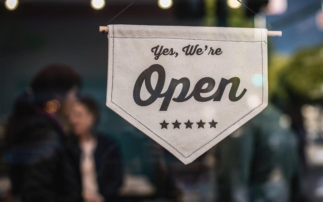 Shop window sign saying - yes we're open
