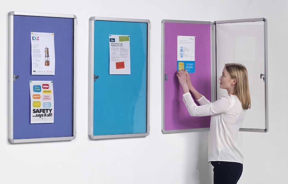 3 colour lockable notices boards on wall with women