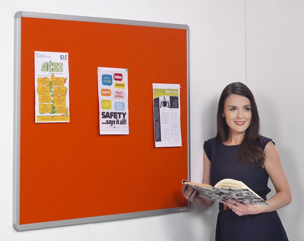 workplace noticeboard with women reading