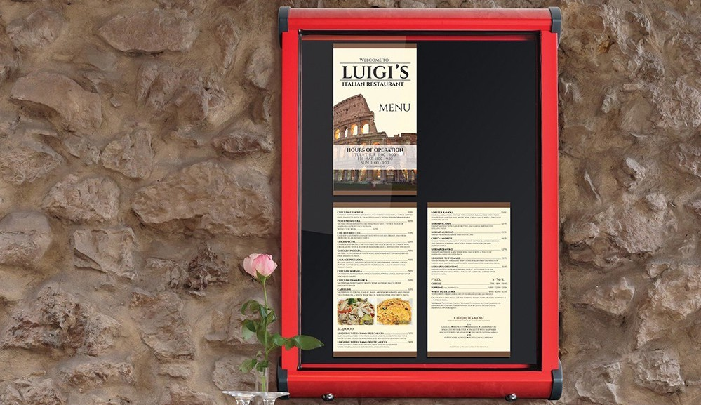 Luigis Restaurant with outdoor noticeboard on wall