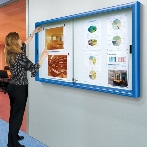 corridor notice board with lockable sliding door in situ