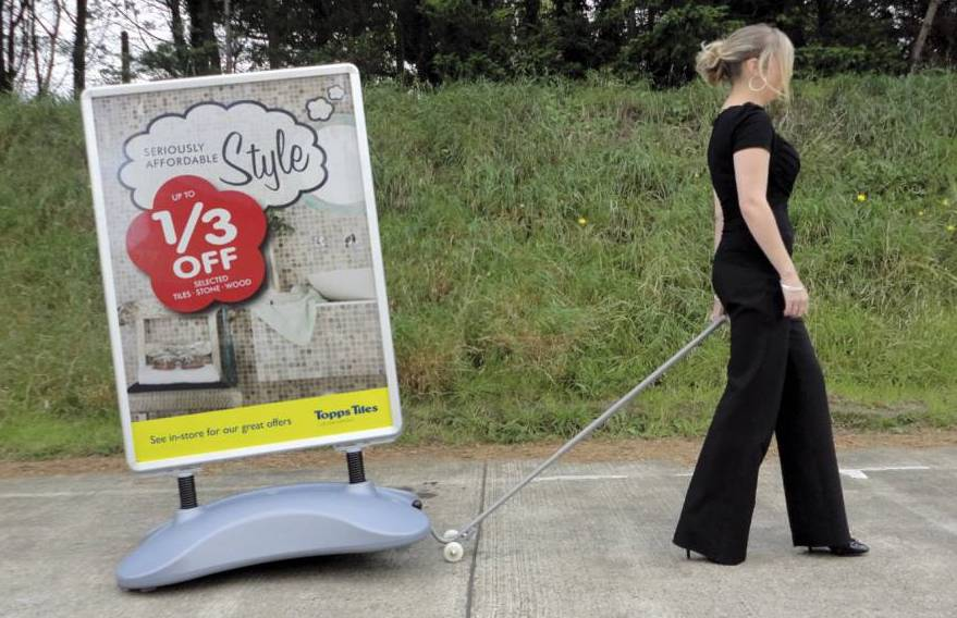 Trolley for moving large pavement signs