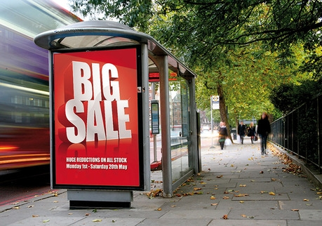 Large lockable poster case sign on bus shelter in high street