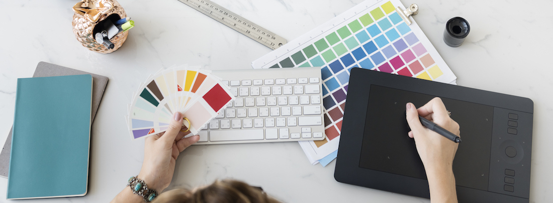 Colour Brainstorming ideas and designs - at desk with colour chart
