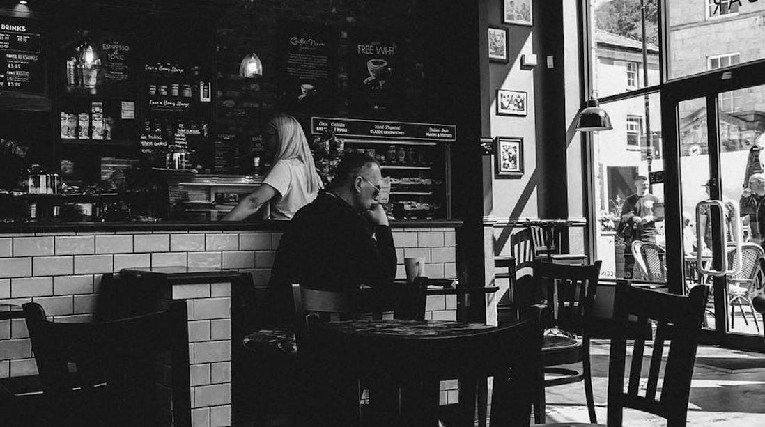 Black and White image of inside of coffee shop
