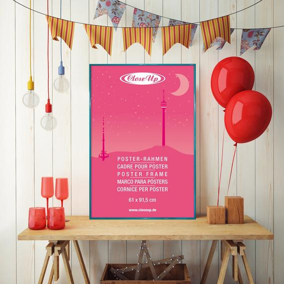Poster frame on desk with bunting and balloons