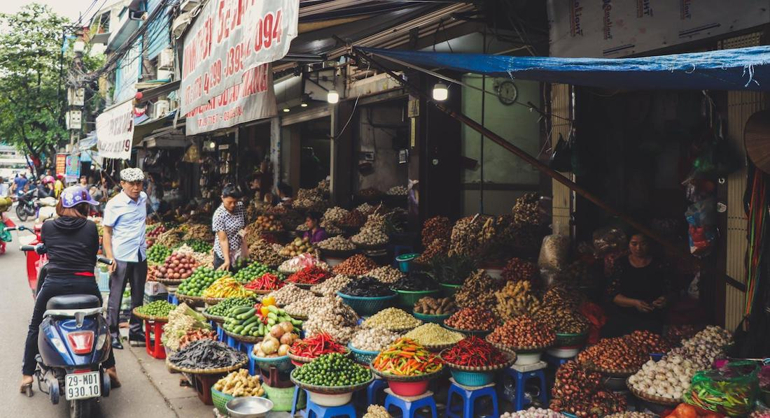 Asian Fruit Stall with Banner