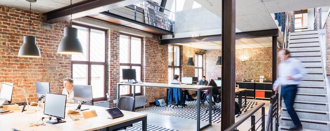 Open Plan Office with Workers at Desks