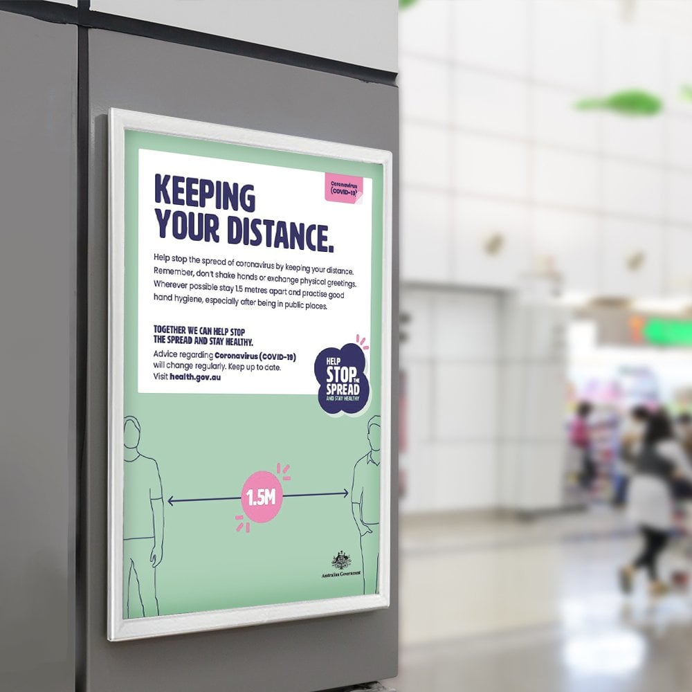 Keep your distance poster in frame in shopping centre