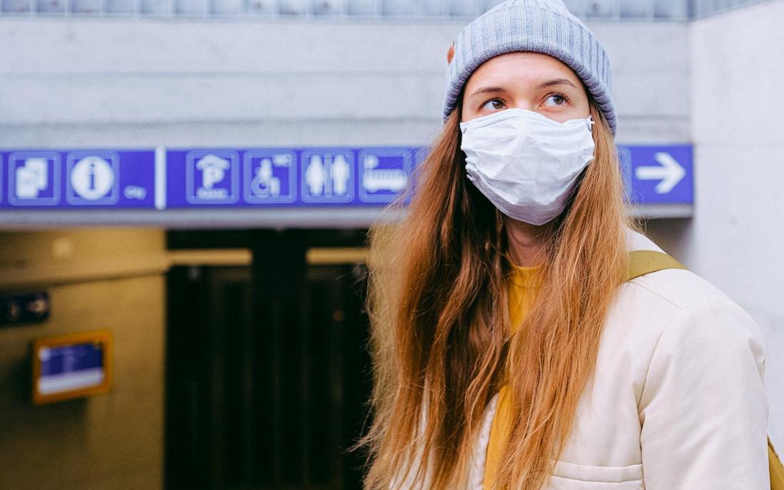 Women wearing a mask pic