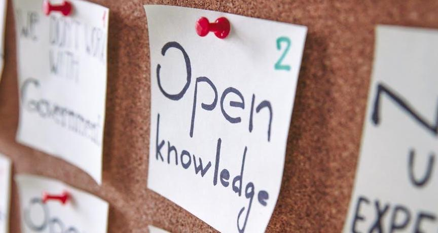 Close up of notice board with pinned note saying Open Knowledge