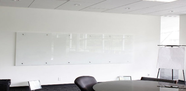 Example of wall mounted glass whiteboard in office boardroom