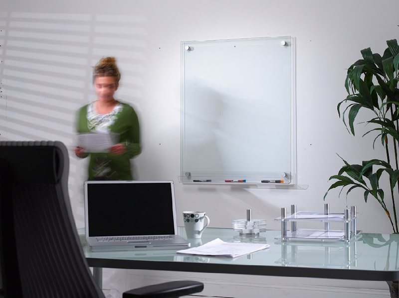 Workplace office with girl and glass whiteboard on wall