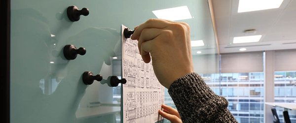 Magnetic pins on a glass whiteboard