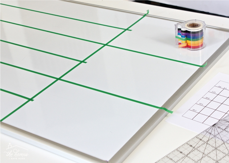 Tape applied to flat whiteboard to make lines