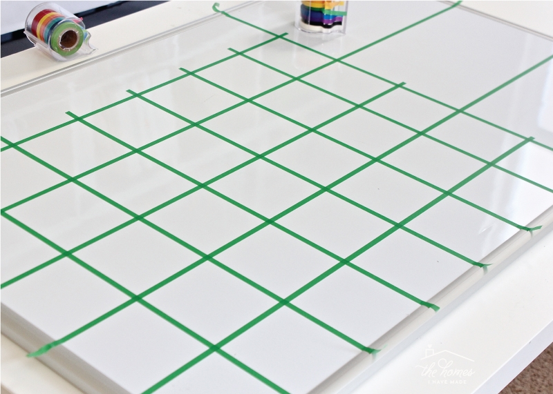 green lined grid on a whiteboard