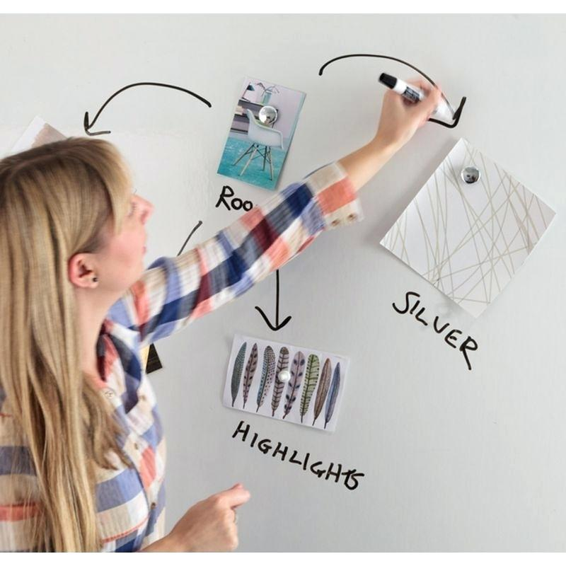 Magnetic whiteboard being used by student with pens and magnets