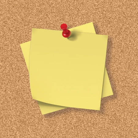 Cork Board with pinned Post It Note