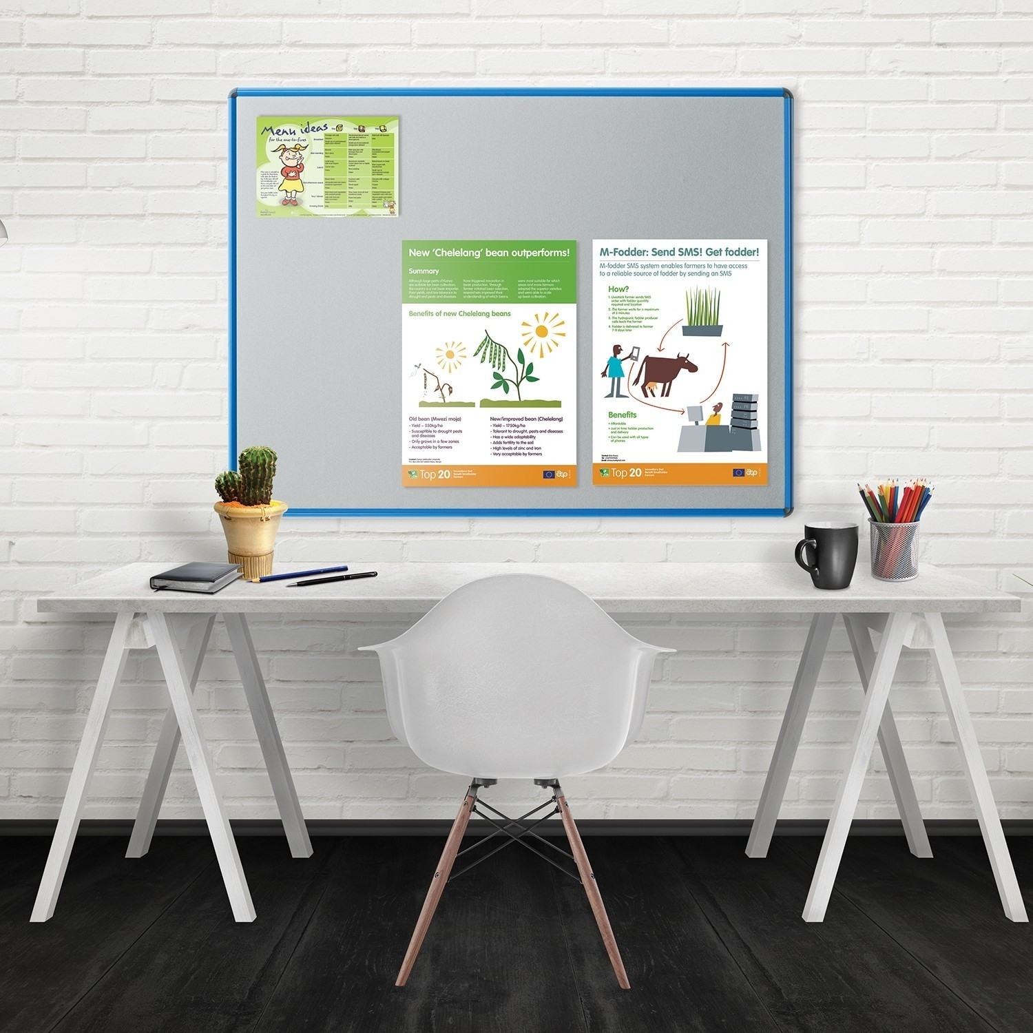 Shield design noticeboard with office desk and chair