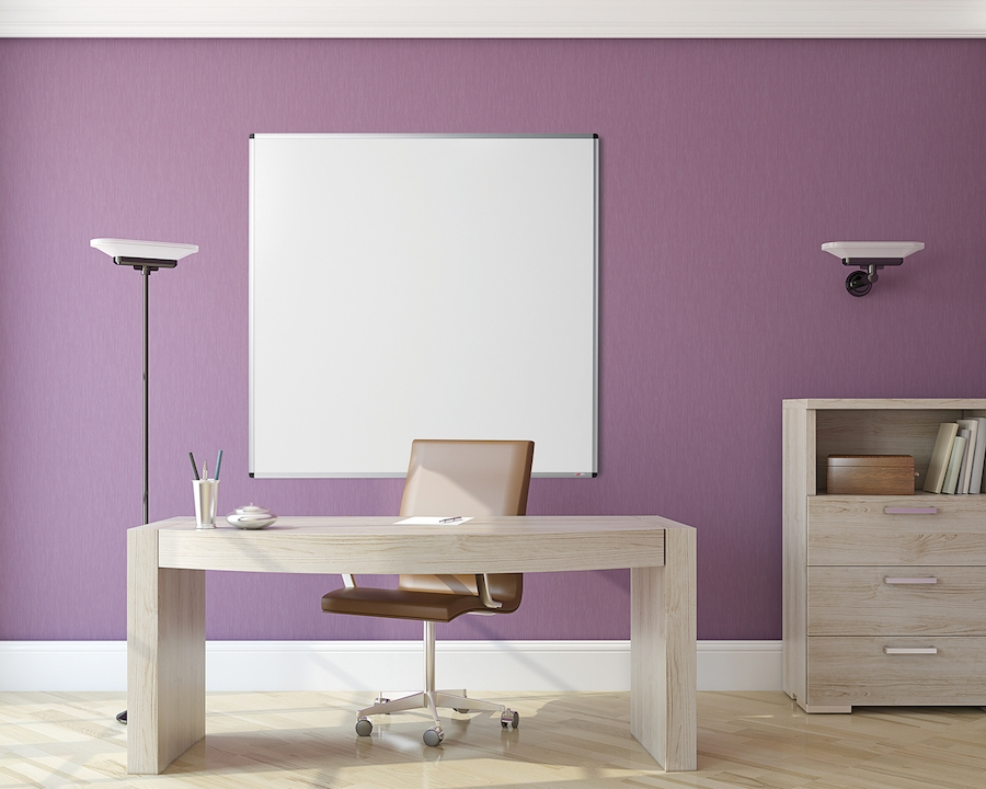 Framed whiteboard with desk in trendy office